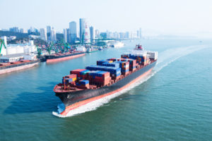 Container ship in transit. China sword policy